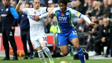 Wigan Athletic's Reece James and Leeds United's Ezgjan Alioski (right). Picture: PA