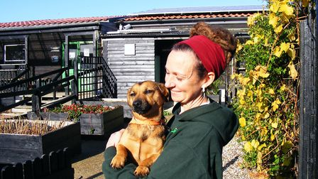 Mrs Goff and Angus, one of three dogs that live on the farm with the goats, horses and sheep. Pictur