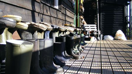 Wellington boots line the wall, ready to be borrowed by vistors. Picture: JAKE FOXFORD