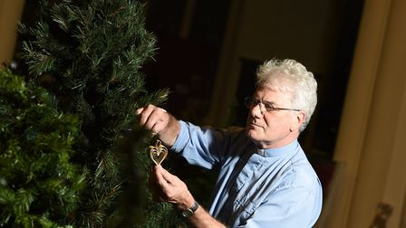Reverend Michael Eden helping to get the church ahead of the annual Christmas Tree Festival in Stowm