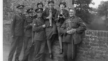ATS women about to strike up a tune with Royal Engineers on the castle bridge. Picture: Framlingham