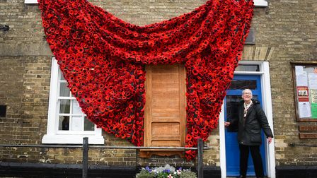More than 5,000 handmade poppies cascade down the side of Woolpit's memorial hall thanks to the work