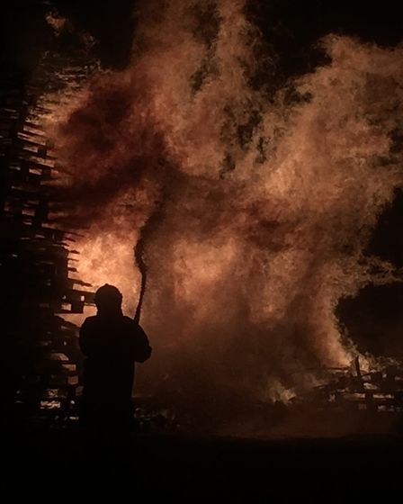 The high winde cause the bonfire to spread faster than organisers had expected. Picture: ARCHANT