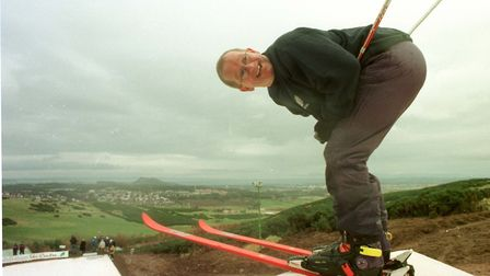 Britain's only Olympic ski jumper Eddie the Eagle, in action at a new 50,000, ski slope which he op