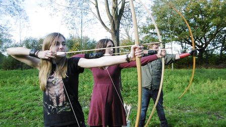 Into the woods at Bures. Archers Kim Senior, Sam Dordoy and Mark Bloom show off their archery skills
