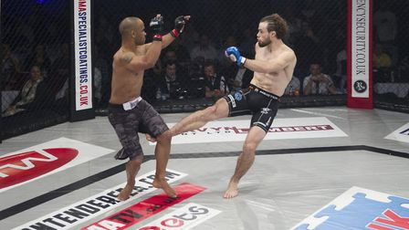 Corrin Eaton lands a leg kick in a fight on the Contenders MMA promotion in Norwich. Picture: JERRY