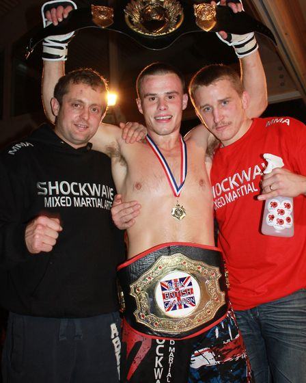 Corrin Eaton, centre, celebrates one of his first title wins early in his fighting career. Picture: