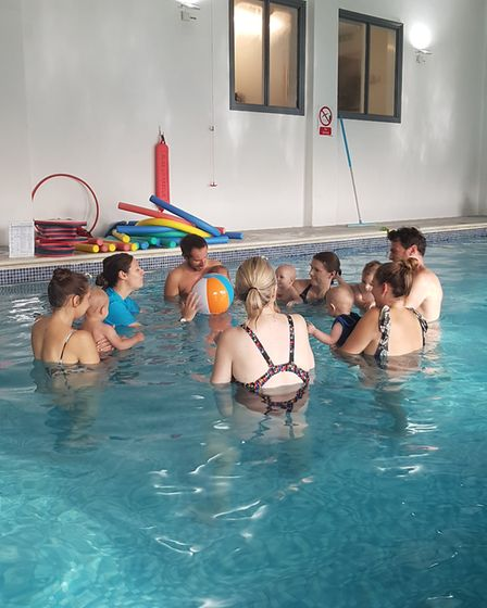 Group activities saw babies pushing an inflatable ball to each other. Picture: RACHEL EDGE