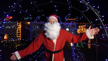 Mike Talbot has covered his house in Christmas lights in aid of EACH and the Felixstowe Volunteer Co