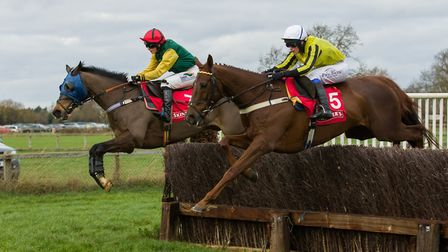 Gina Andrews, left, on her way to win number 200 aboard Sharp Suit at Cottenham. Picture: GRAHAM BIS