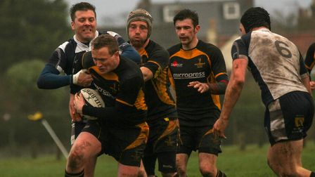 Josh Crick tries to find a way through for Southwold. Picture: LINDA CAYLEY