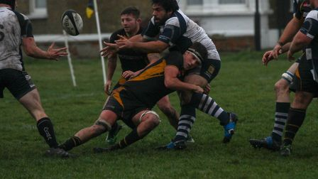Milo Cawkwell makes a tackle for Southwold. Picture: LINDA CAYLEY