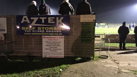 The quirky stand behind one end of Top Field, with fans waiting for kick-off between Hitchin Town an