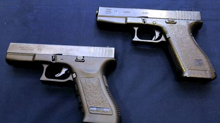 Two pistols, one genuine (left) and one replica (right). Picture: SARAH LUCY BROWN