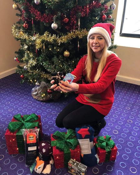 Christmas wrapping elf Faye Ellis, a parent of a former patient and volunteer at the launch of the C