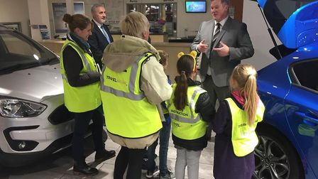 Hammond Ford sales executive James Coe explains to Holton Primary School pupils learn how reducing t