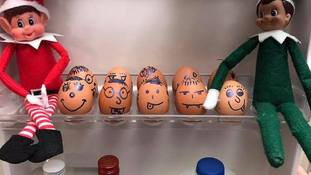 A couple of elves even decorating the eggs in the fridge Picture: ABBEY FARTHING