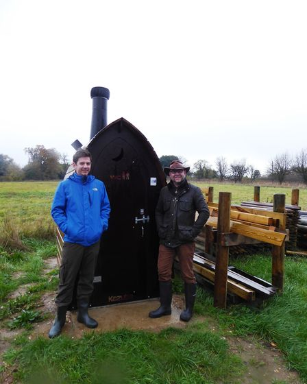 Ben Orchard and Richard Carter outside the waterless toilet at Church Farm Marshes reserve