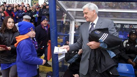 Sir Bobby Robson signs an autograph on his return to Portman Road with Newcastle