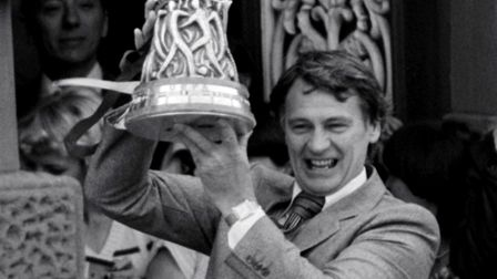 Ipswich Town manager Bobby Robson holds aloft the UEFA Cup.
