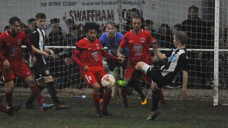 Action in the goalmouth at the Swaffham Town against Stow. Picture: DENISE BRADLEY