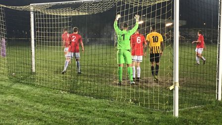 Swaffham Town keeper Tommy Rix prepares to deal with a Stowmarket corner at Greens Meadow. Picture: