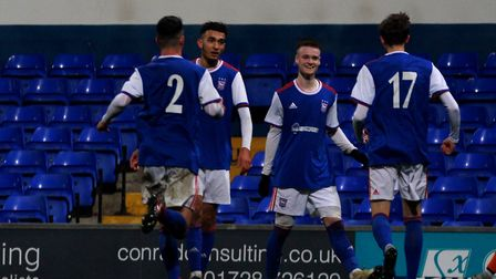 Town U18s celebrate their fourth goal in the Youth Cup Picture: ROSS HALLS