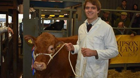 Lee Byam with Geoff Freeman's winning beast at Colchester Christmas Prime Stock Show Picture: STEVE