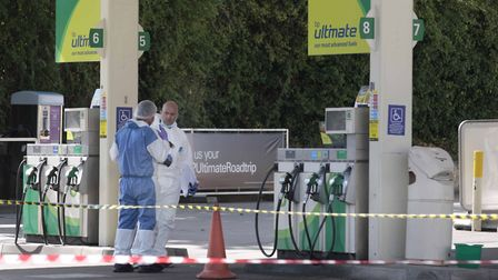 Forensic officers working at the scene of the murder at the BP Garage in Baddow Road, Chelmsford Pic