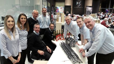 John Grose employees helping to run the quiz night at the Ipswich dealerships. Picture: John Grose