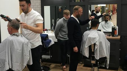 Gould Barbers in Newmarket raised nearly £600 for charity on its opening day Picture: TO THE END