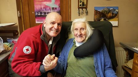 Care worker Pat Fisher with John Raven from Woodbridge Picture: BRITISH RED CROSS