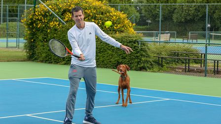 Tim Henman with a ball-dog ahead of Champions Tennis in London Picture: CASEY GUTTERIDGE