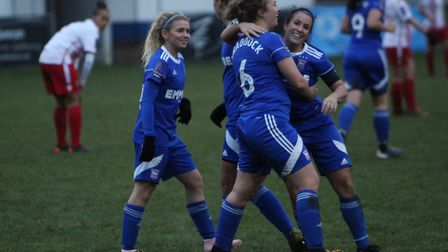 Kerry Stimson celebrates her goal with her fellow team-mates Picture: ROSS HALLS