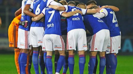 Luke Chambers speaks to his Ipswich Town team-mates in the pre-match huddle. Photo: Steve Waller