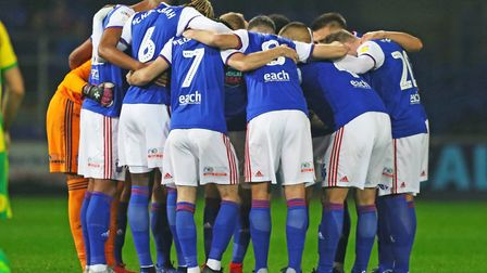 Town players in a huddle ahead of the Ipswich Town v West Bromwich Albion game. Picture: STEVE WA