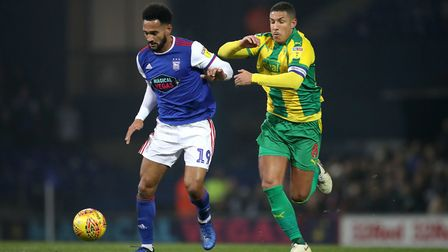 Ipswich Town's Jordan Roberts (left) and West Bromwich Albion's Jake Livermore battle for the ball d