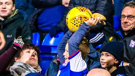 A young fan takes a break from his burger to throw the ball back to his heroes on Friday night. Pict