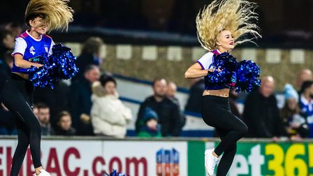 Cheerleaders on the pitch during the halftime break. Picture: STEVE WALLER