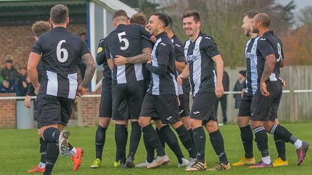 Woodbridge Town celebrate during their 5-1 win over Hadleigh. Picture: PAUL LEECH