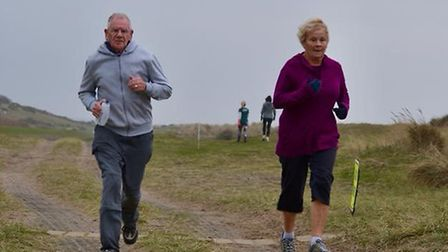 Runners enjoy the sandy grassland tracks that make up the 5K course at the Sizewell parkrun. A field