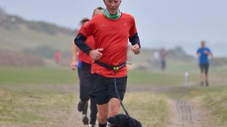 Man and dog in action at Saturday's Sizewell parkrun. Picture: SIZEWELL PARKRUN FACEBOOK PAGE