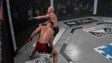Ryan Dennis lands a huge right hand on Baruc Martin to win their fight at Contenders 25. Picture: BR