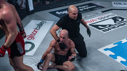 Referee Dan Movahedi stops the fight at Contenders 25, saving Baruc Martin from further punishment.