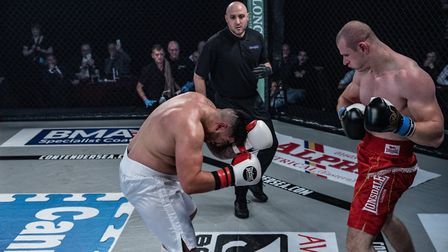 Giant Norwich heavyweight Jakub Adamski, right, on his way to victory at Contenders 25. Picture: BRE