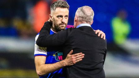 Lambert puts an arm around a disappointed Cole Skuse at the final whistle. Photo: Steve Waller