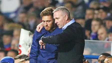 Town manager Paul Lambert gives instructions to substitute Teddy Bishop ahead of his introduction in