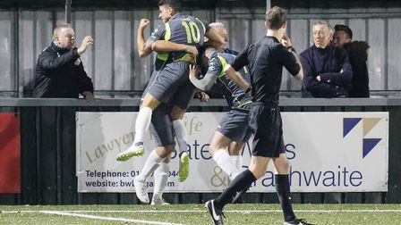 Grays celebrate their winning goal at AFC Sudbury. Picture: PAUL VOLLER