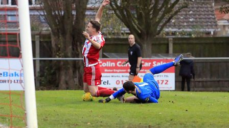 Felixstowe win a penalty as Jordy Matthews is brought down by Withams's keeper Luca Collins. Picture