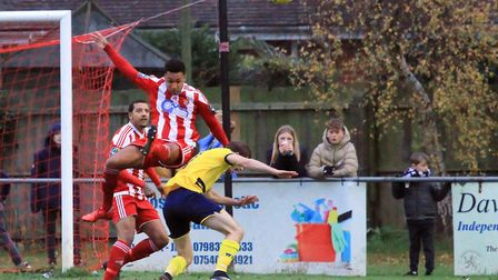 Rhys Henry heads clear for Felixstowe. Picture: CARL NEWELL